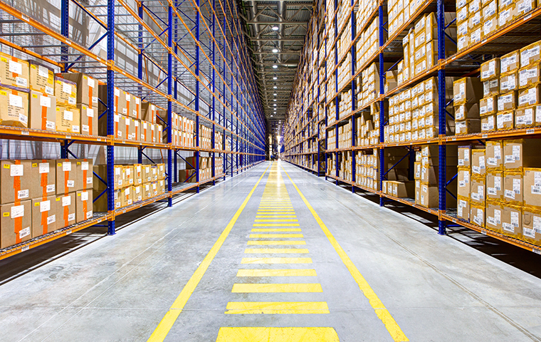 the interior of a large california warehouse looking down a long aisle