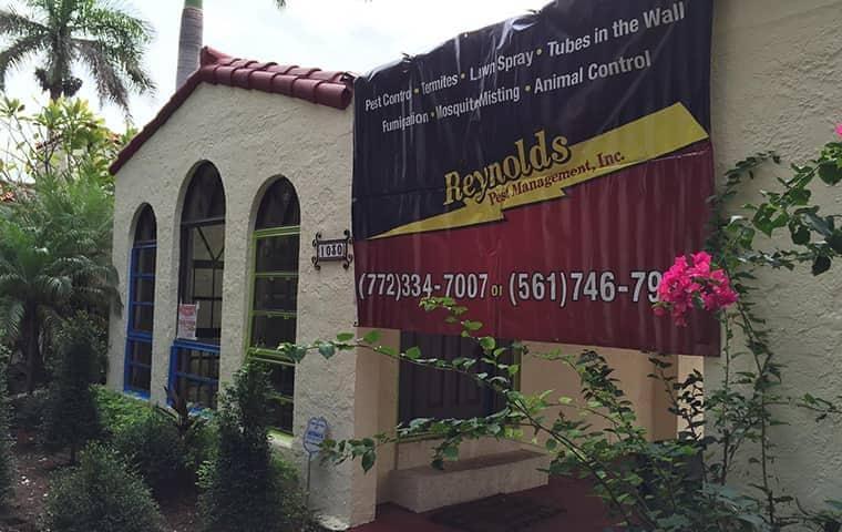 reynolds pest management sign on a home