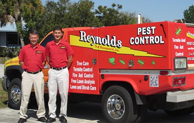 owners with pest control service truck in Jupiter Florida