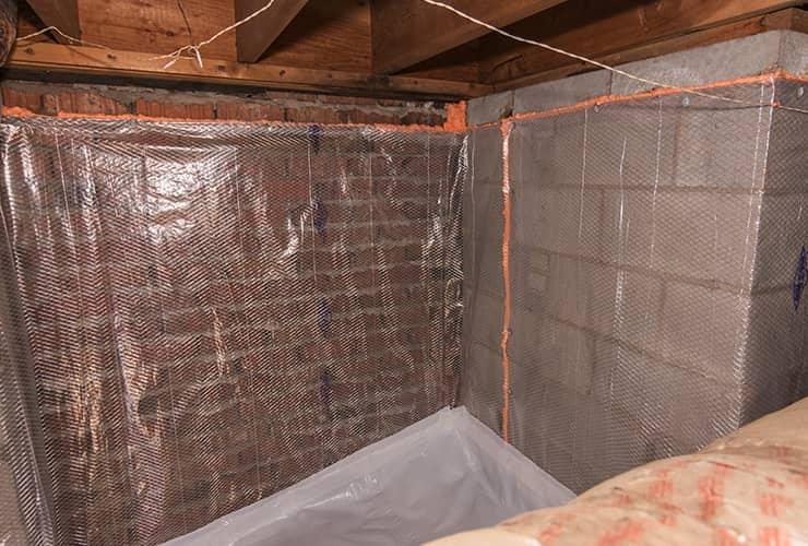 plastic wrapped crawl space prepared for moisture control and pest control