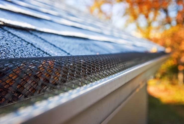 residential home with gutter leaf blocker installed