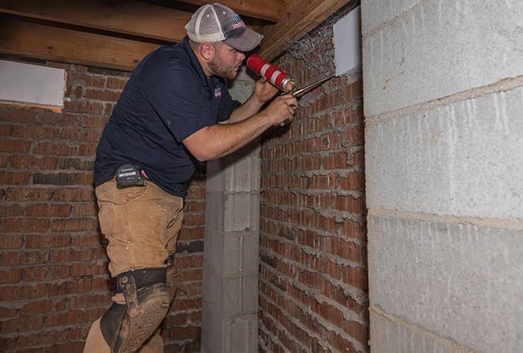 pest control technician moisture proofing a home