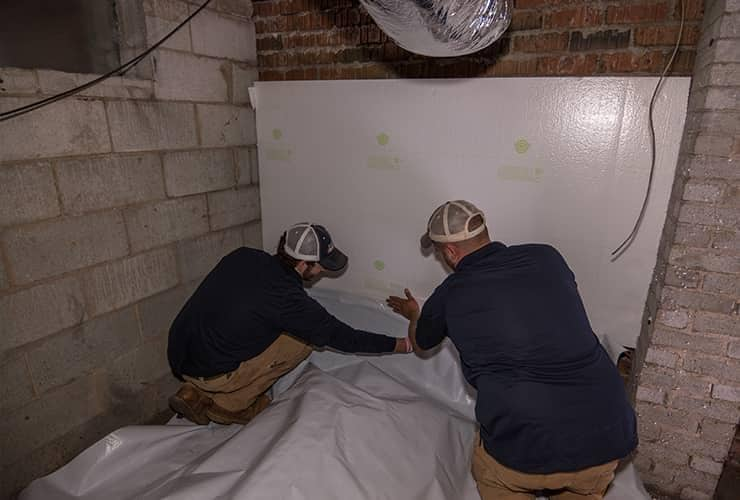 two men installing moisture control in a south carolina home
