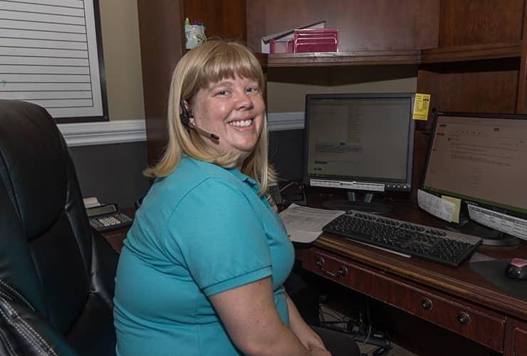 spencer pest control employee at her desk