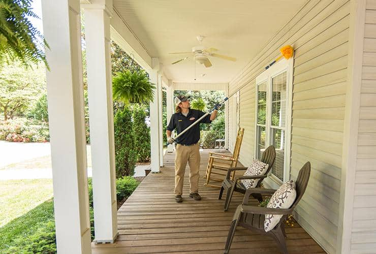 pest control tech treating exterior