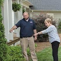 a greenville pest professional showing homeowner conditions that attract mosquitoes