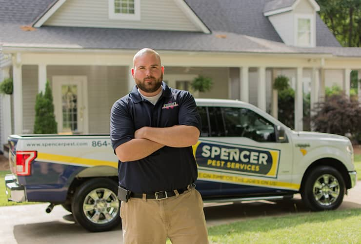 mauldin sc pest control tech in front of spencer truck