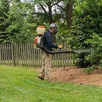pest control technician conducting mosquito control service