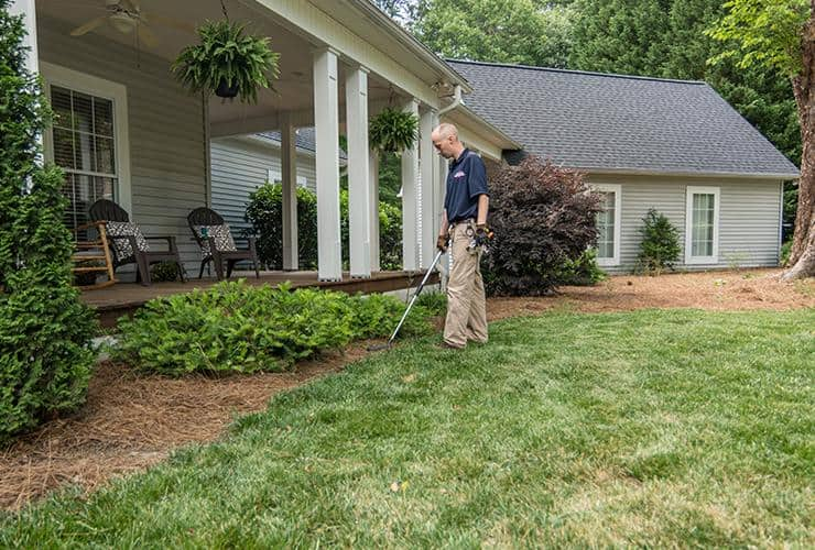 spencer service professional inspecting property for termites