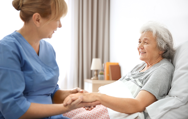 a nurse and an elderly woman in a nursing home in canton
