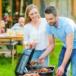 family enjoying barbecue