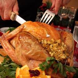 springfield man cutting turkey for thanksgiving