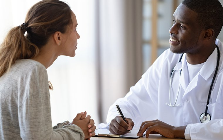 a male doctor with a female patient