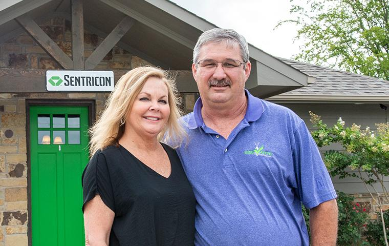 kelly and tony santangelo standing in front of the innovative pest control office