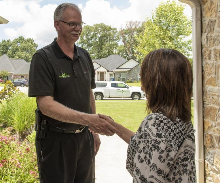 innovative pest control tech greeting longview tx homeowner