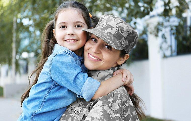 military woman and her daughter