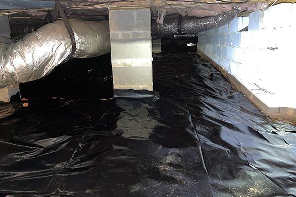 a crawl space after vapor barrier treatment