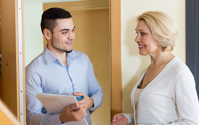 a cadenhead services service technician visiting a residential homeowner in milton florida