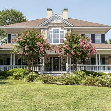 a two story home with large porch in baton rouge louisiana