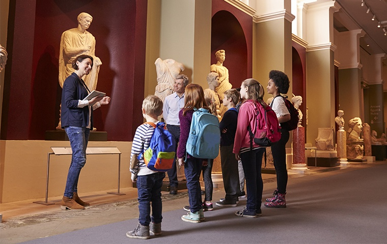 children looking at a statue in a museum