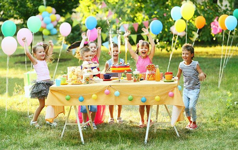 four children outside at a birthday party