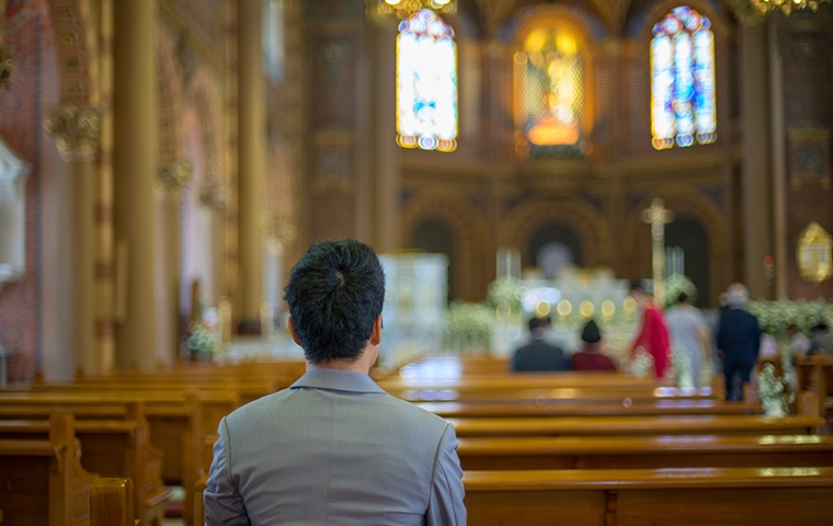 a man sitting in a place of worship