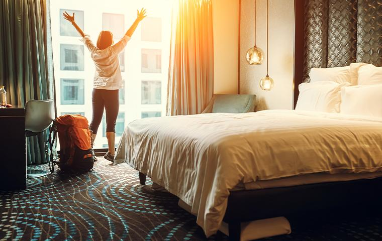 person stretching in hotel room