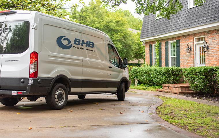 van pulling up to house for followup