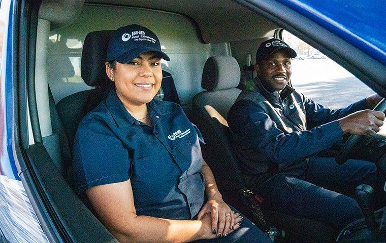 two bhb technicians in a company van