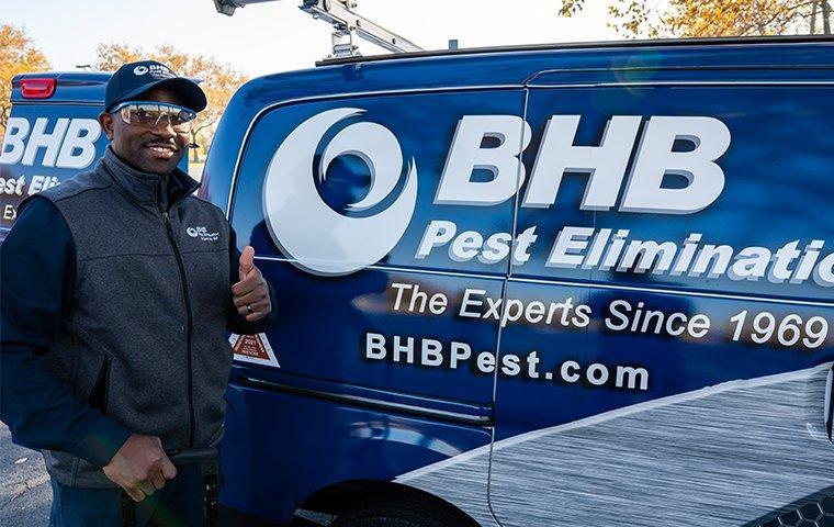 bhb technician in front of company van