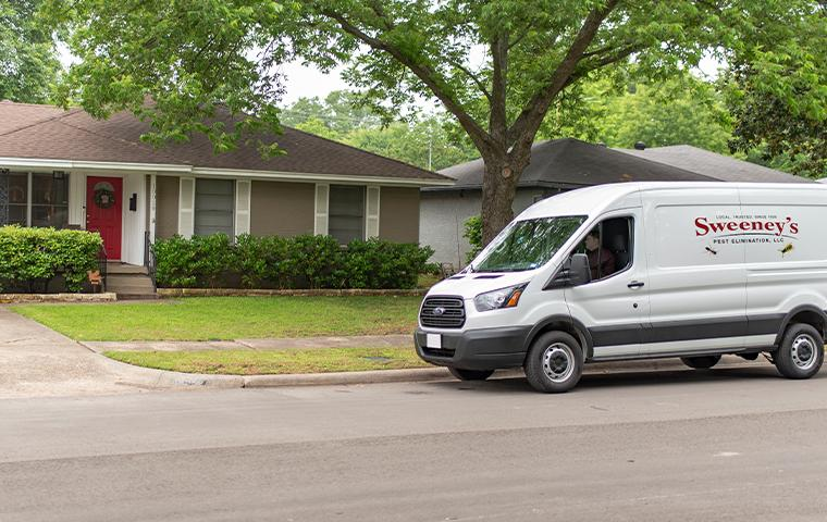 van pulling up in front of house