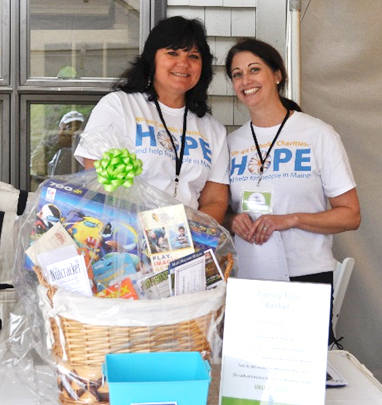 Catholic Charities' volunteers help out at a fund-raising event in Maine. Enrich your own life while bringing hope to someone else!
