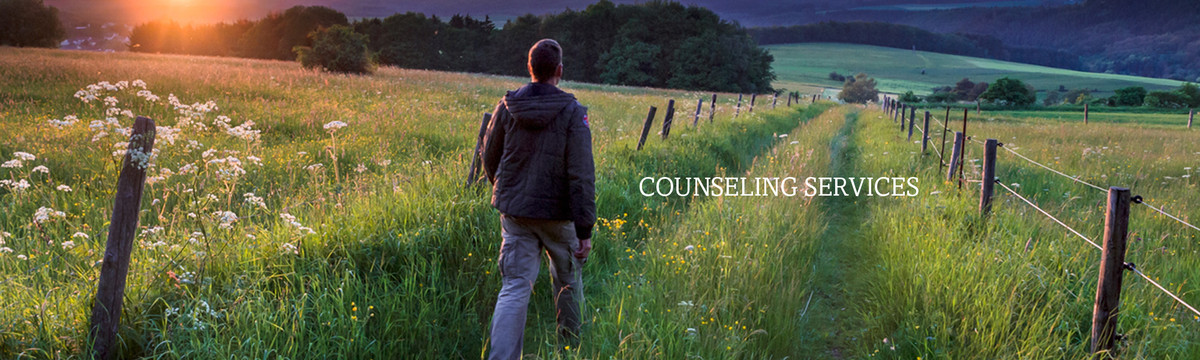 A man walks through a field. Catholic Charities' Counseling Services offer hope for improved quality of life.