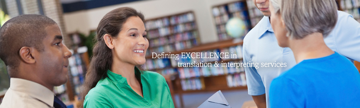 A group of four adults stand together in conversation. Catholic Charities Language Partners —defining excellence in translation and interpreting services in medical, legal, social services, corporate and other fields.