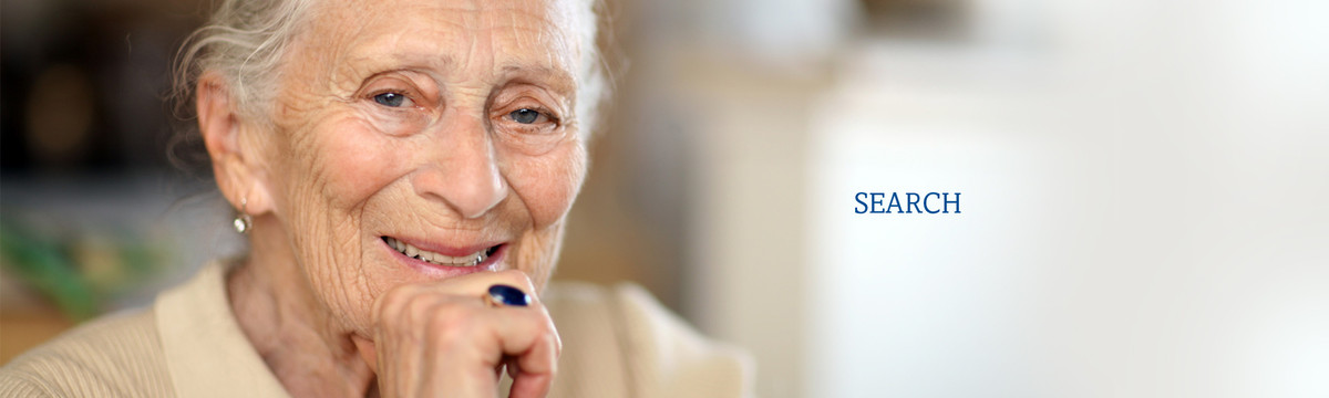 An older woman smiles. We offer friendly visitation and help for isolated seniors and disabled indviduals.