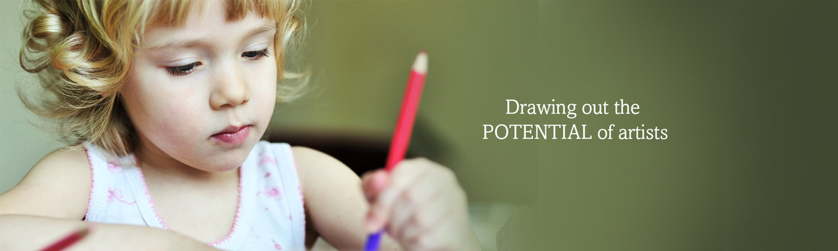 """""""A young girl draws with a color pencil. We're committied to providing compassionate, comprehensive child care that draws the full potential from children aged six weeks to seven years."""
