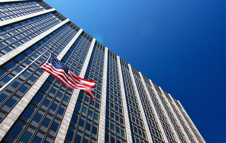 a large government building with the american flag