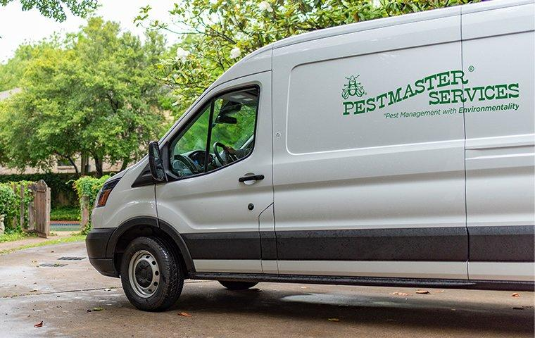 pestmaster services vehicle in driveway