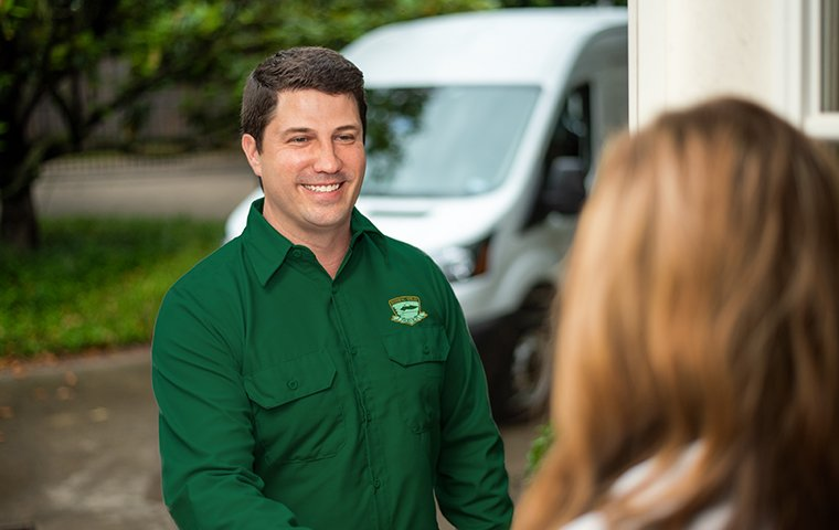 technician greeting a homeowner