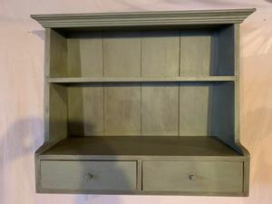 Wall shelves with crown molding and two side-by-side drawers