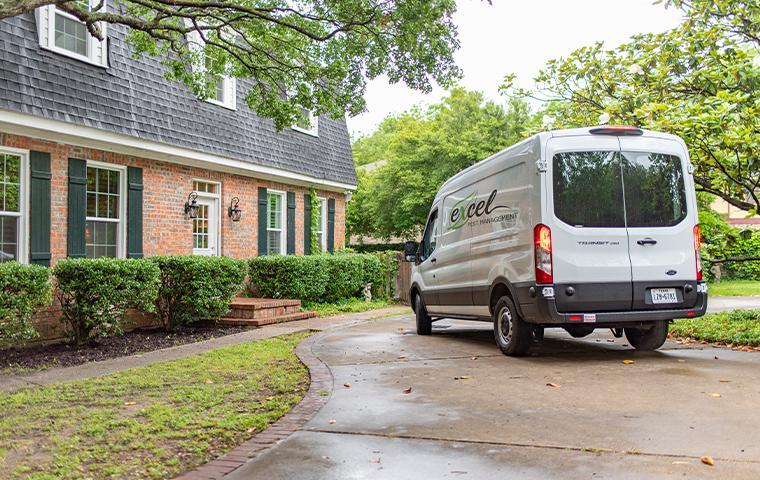 van with logo in driveway