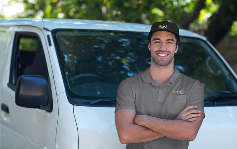 technician standing in front of van