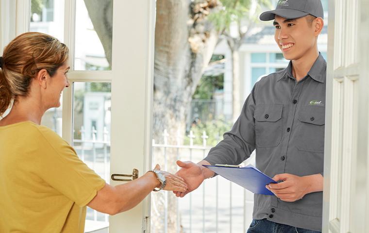 technician greeting customer at door