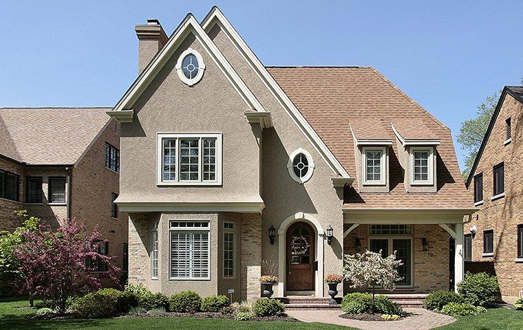 street view of a large brick home in frisco texas