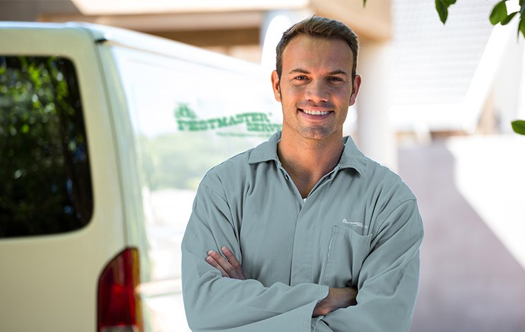 a friendly pestmaster services technician