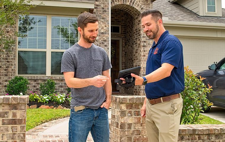technician and client talking outside of home