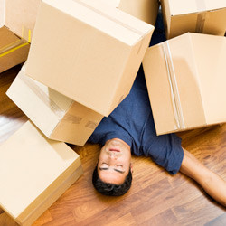 image of a man with moving boxes