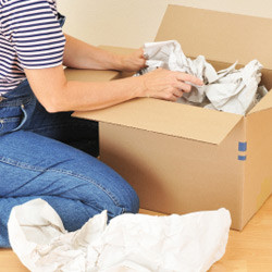 woman getting her boxes ready for a move