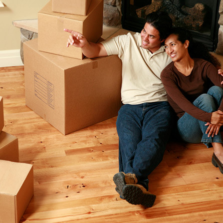 couple sitting among moving boxes
