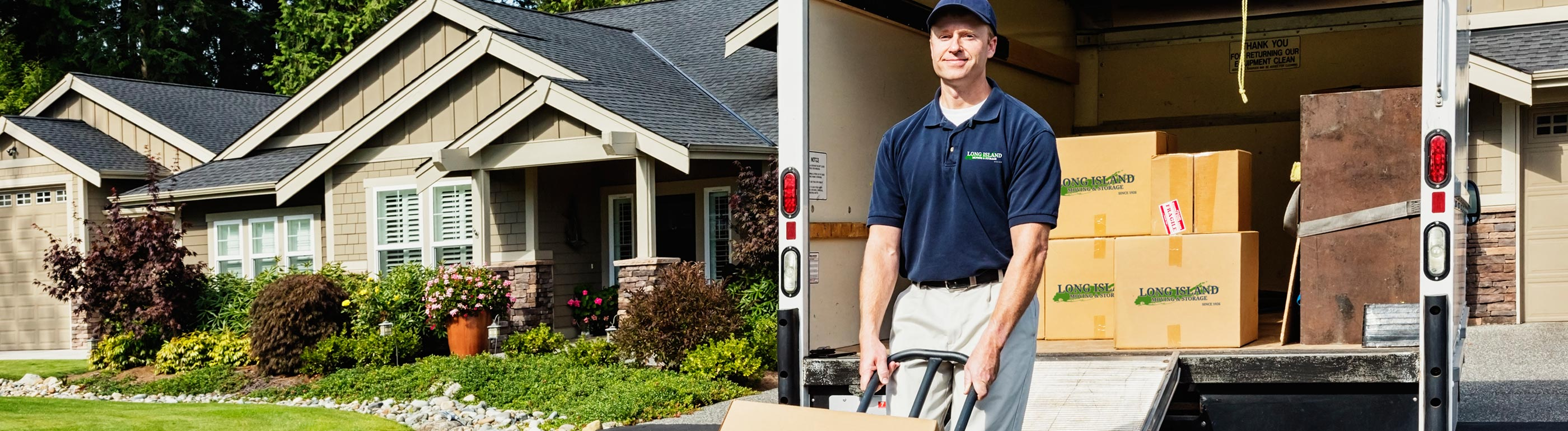 residential movers packing up moving van